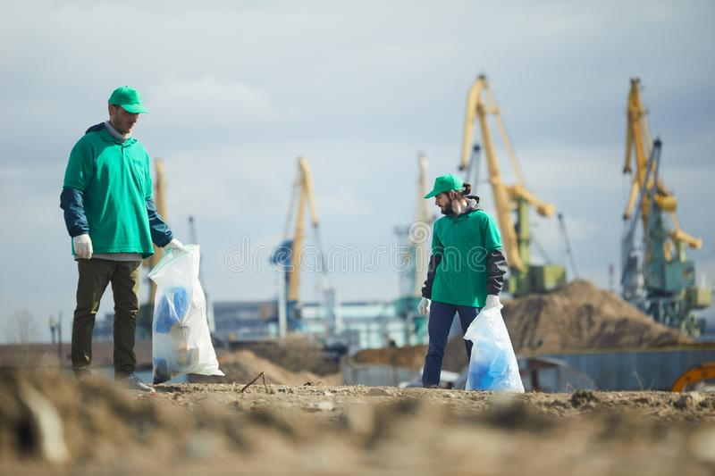 Activists picking litter on site royalty free stock photos