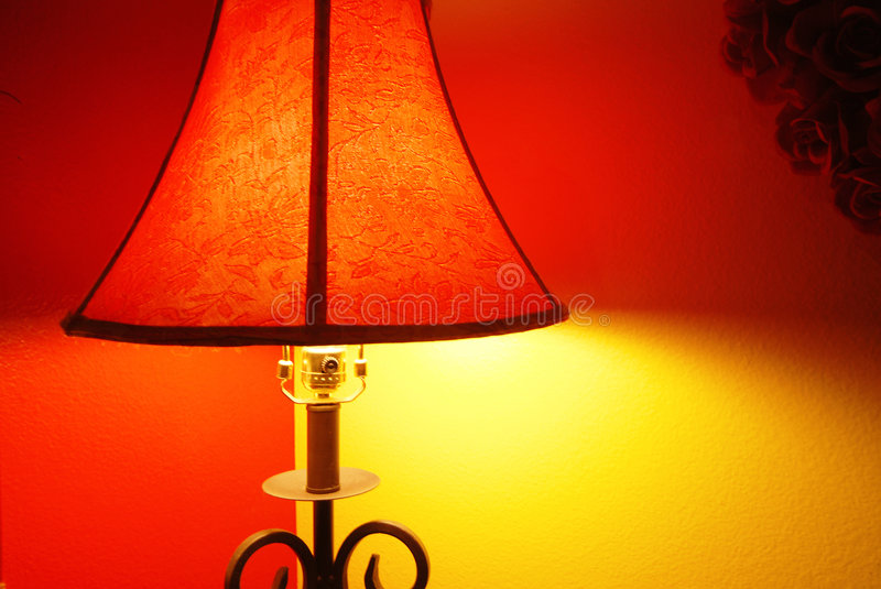 Two Wall Lamp. Corner of red and yellow walls contrast lamp lighting stock photo