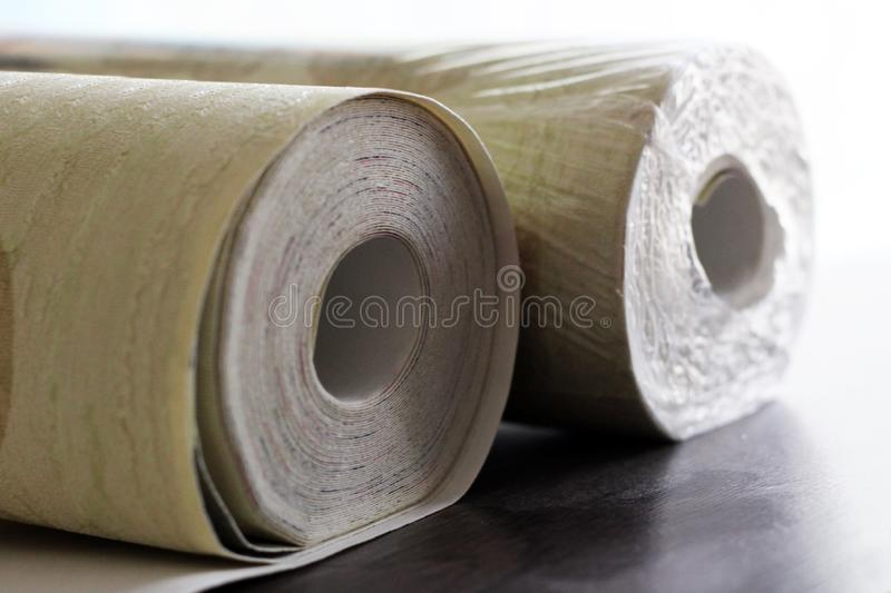 Two Wallpaper rolls so close stock image