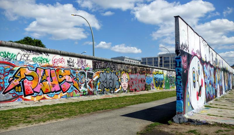 Two walls in Berlin one in front of the other with sketches, graffiti and colored writings. Symbol of the city. Germany royalty free stock photography