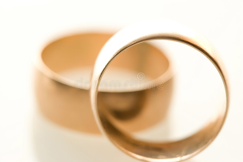 Two Wedding bands. Wedding bands, symbol of marriage and eternal love royalty free stock photo