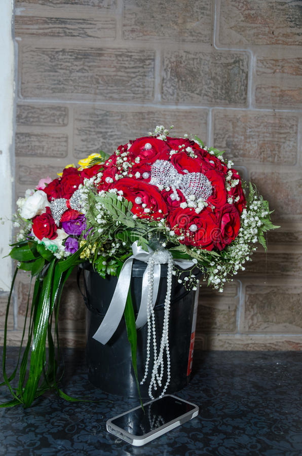 Two wedding bouquet of red roses and other colorful flowers and mobile phone. Rahat, Negev, Israel September 11, Wedding - Beer-Sheva-Rahat, 2015 in Israel royalty free stock photography