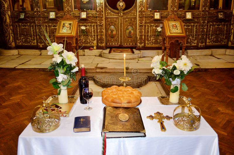 Two Wedding Crowns in the Church. Table with Wedding Crowns in the Church stock photo