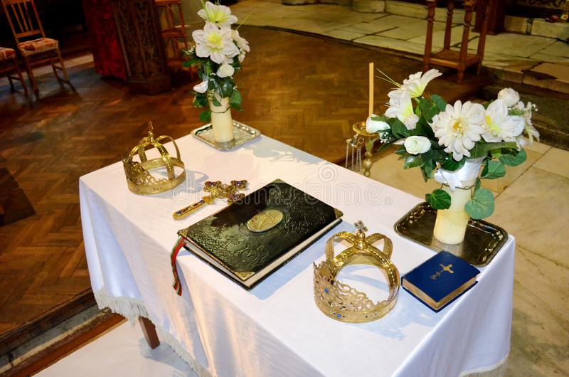 Two Wedding Crowns in the Church. Table with Wedding Crowns in the Church royalty free stock image