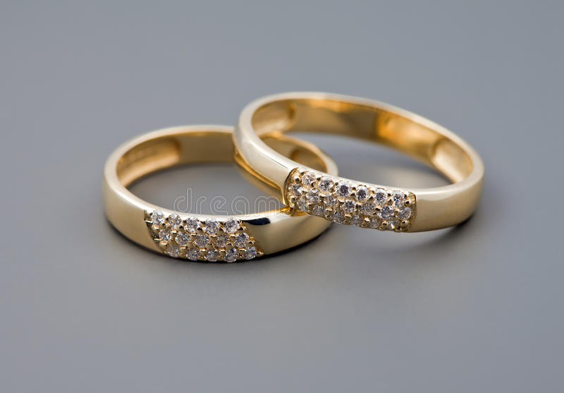 Two wedding rings. Celebratory accessories - two rings for wedding day and card stock images