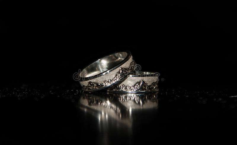 Two Wedding Rings On A Black Background Stock Photo Image of