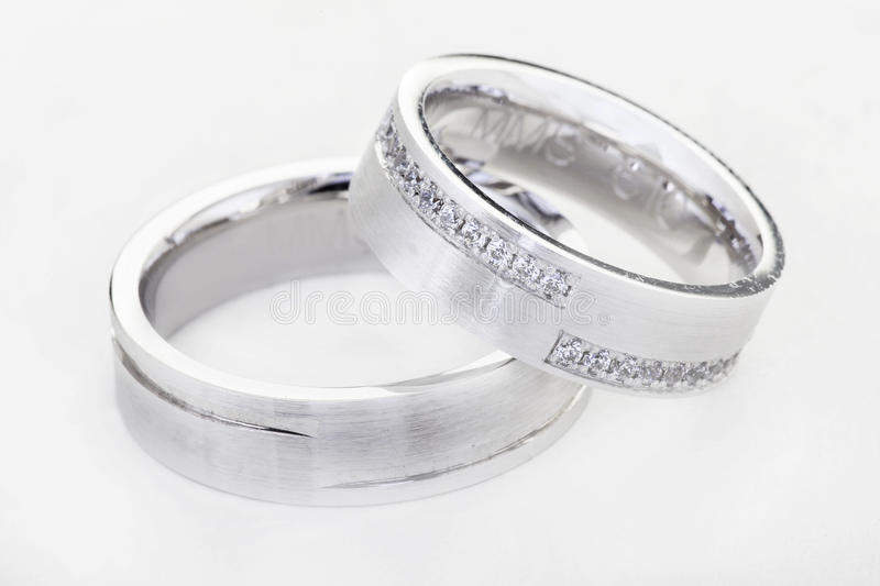 Two wedding rings isolated on white stock images
