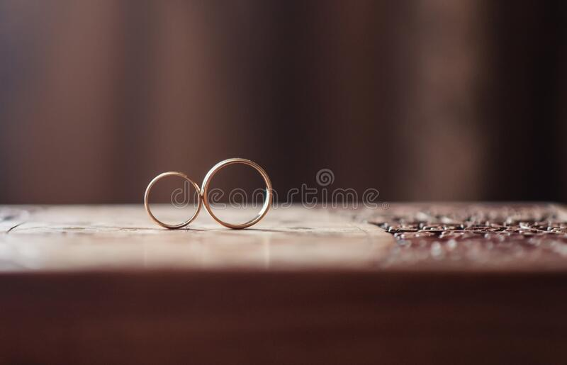 Two wedding rings stand. On a table stock photos