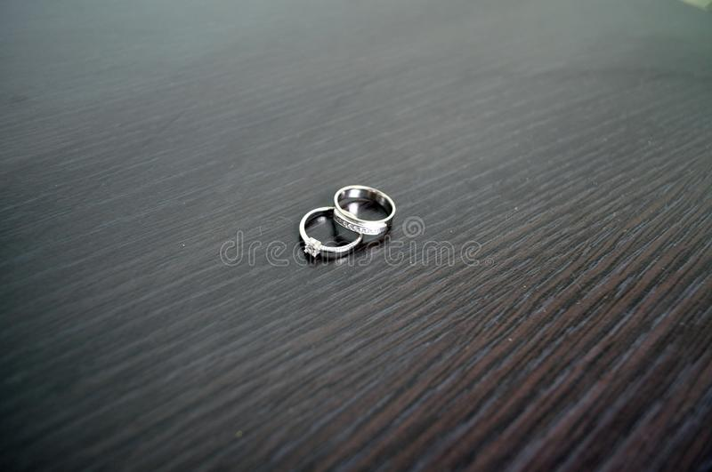 Two wedding rings in white gold with diamonds royalty free stock photos