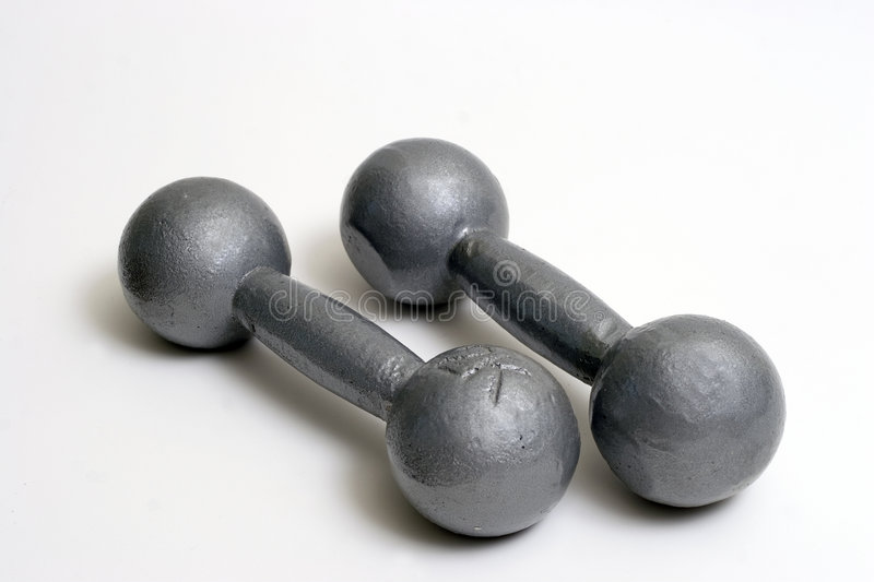 Two weights laying stock photo