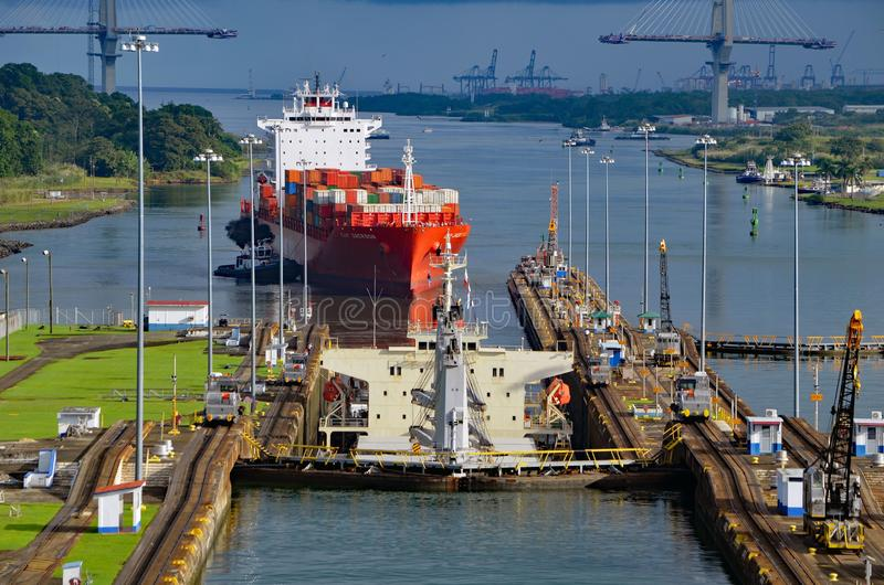 Two westbound container ships transiting the Gatun Locks on the Panama Canal. Two westbound container ships transiting the Panama Canal. One container ship in stock image