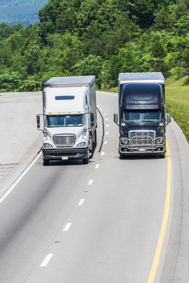 Two Trucks on Interstate Highway Vertical with Copy Space royalty free stock photos
