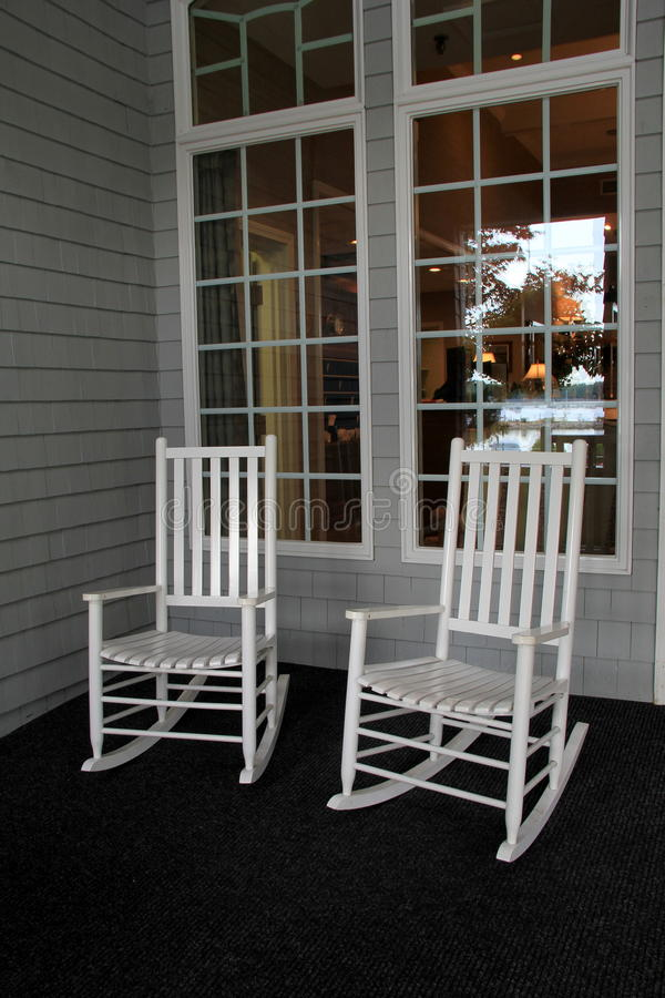 Two White Adirondack Rocking Chairs On Front Porch Stock
