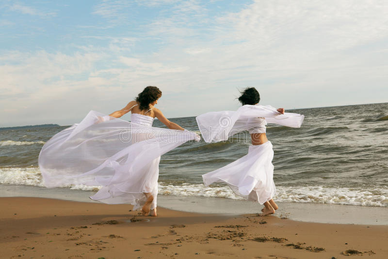 Two white angels on the beach royalty free stock photo