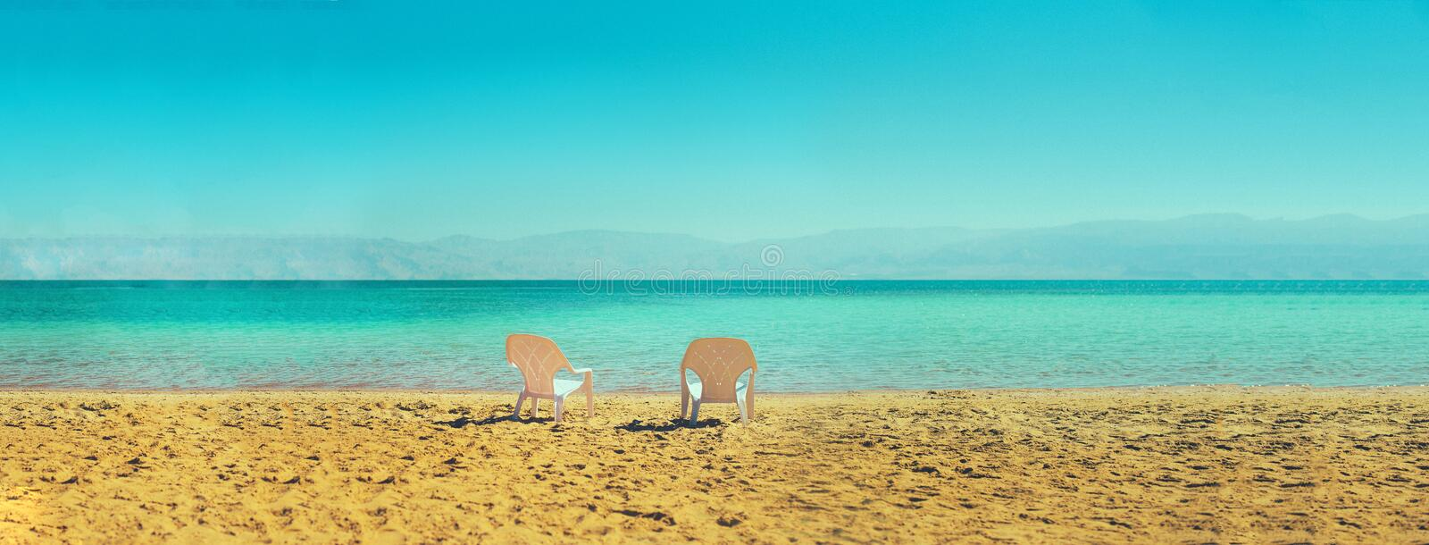 Two white beach chairs on seaside. Copy space. Summer, holiday and travel concept. Banner stock images