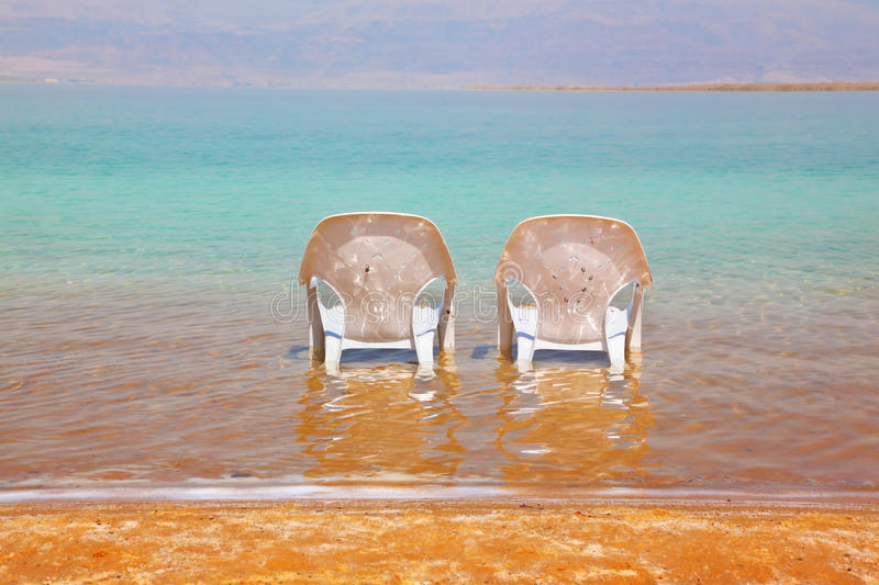 Two White Beach Chairs Stood Side By Side Royalty Free Stock Images
