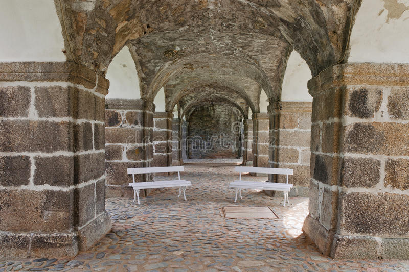 Two white benches. In corridor of the castle Bečov in Czech Republic royalty free stock image