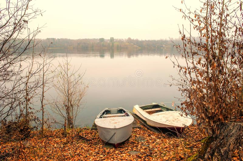 Two white boats on the banks of the Volga river in late autumn. Ples old Russian city in Russia the city is associated with the. Beautiful view of the Volga stock photos