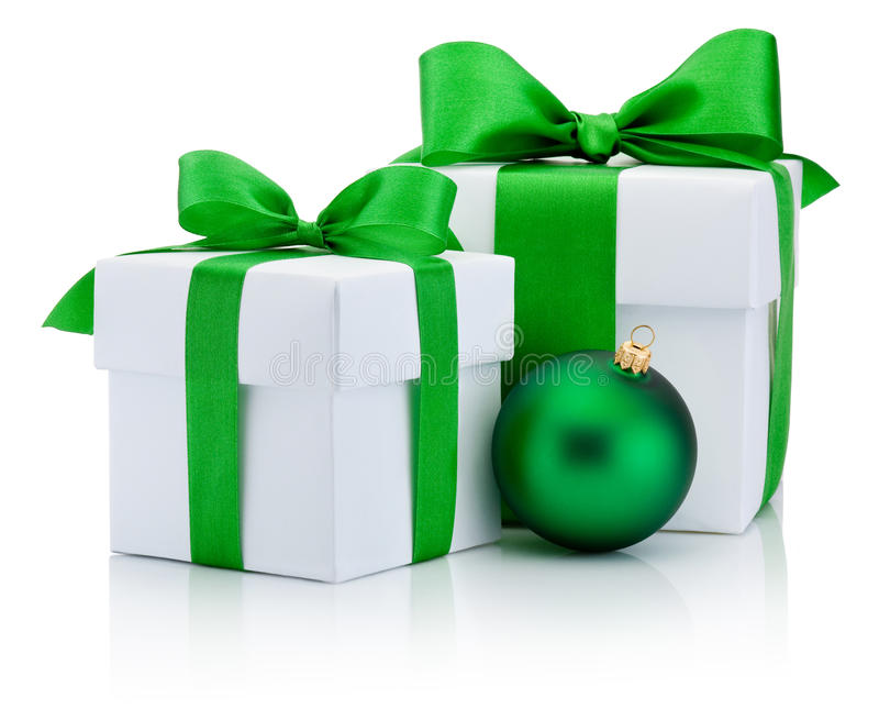Two White boxs tied green satin ribbon bow and christmas ball. Isolated on white background stock images