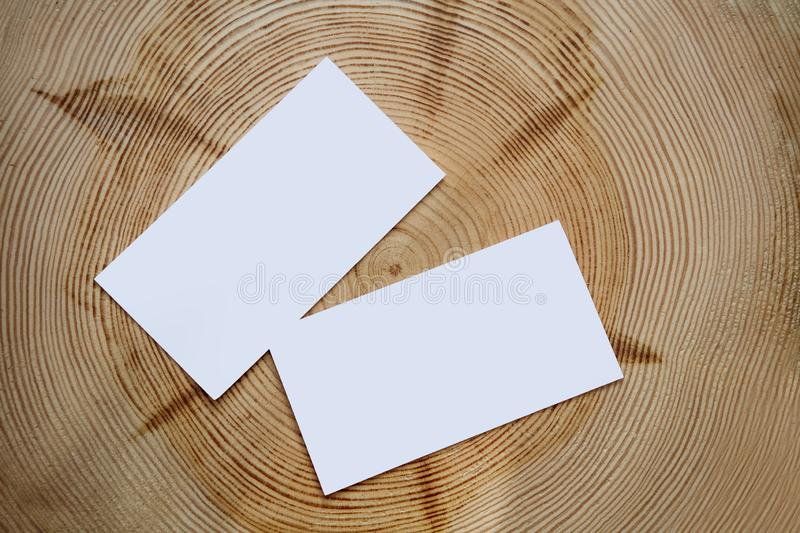 Two white cards decorated wooden background royalty free stock photo