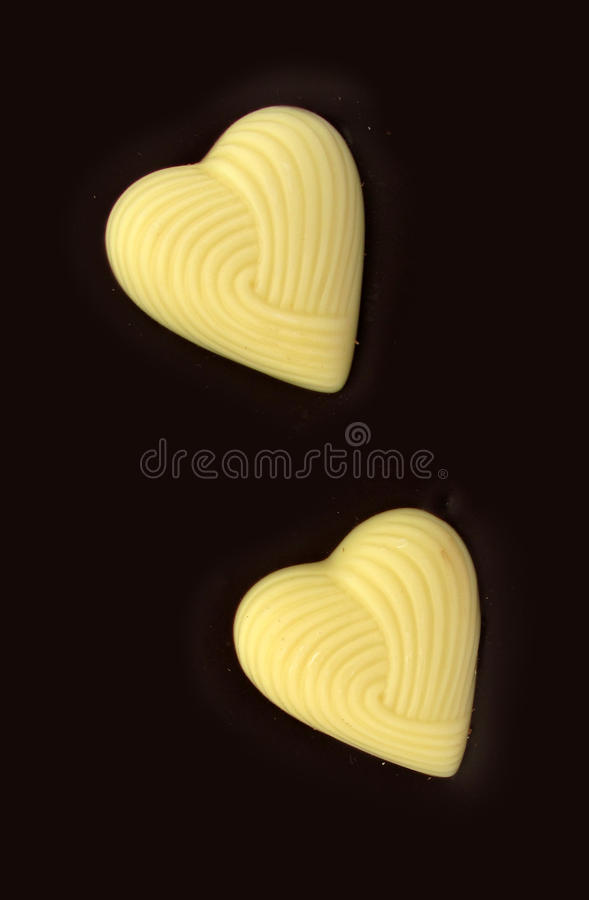 Two white chocolate hearts