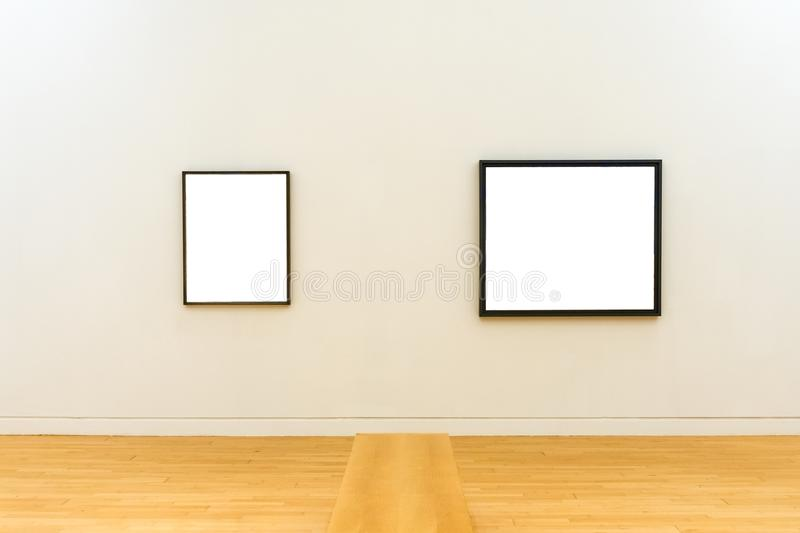 Two white clipped paintings with wooden frames stock images
