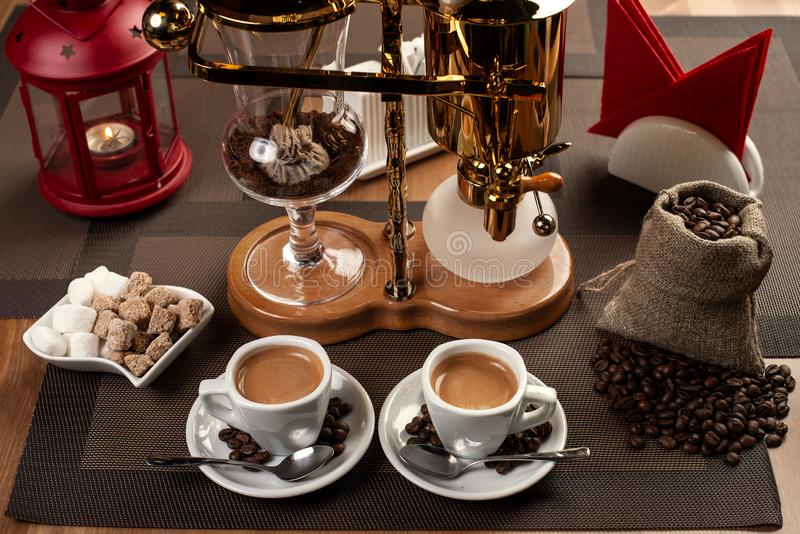 Two cup with black coffee and geyser coffeepot royalty free stock photos