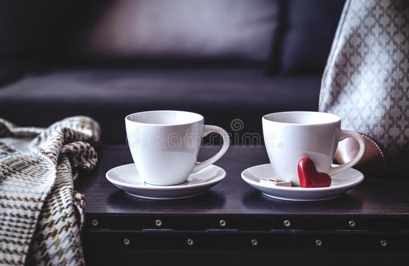 Two white cups of morning coffee on the table royalty free stock image