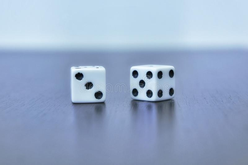 Two white dice - cubes on gray background. stock photos
