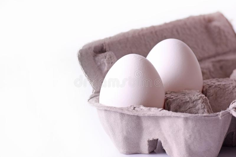 Two white Egg and tray stock photo