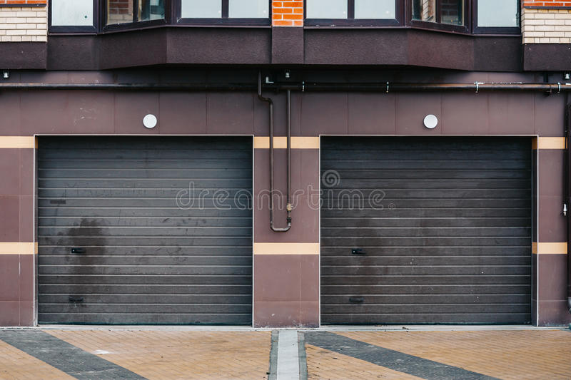 Two White Garage Doors For Parking In Residential House Stock Photo
