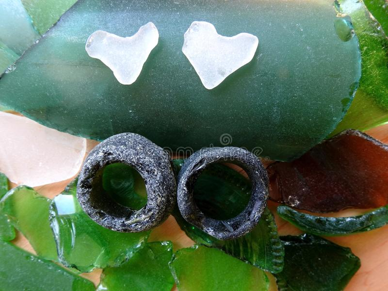 Different sea glass pieces - rind and heart , Lithuania royalty free stock photography
