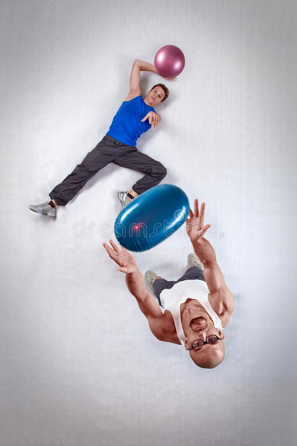 Two white men throwing balls stock photography