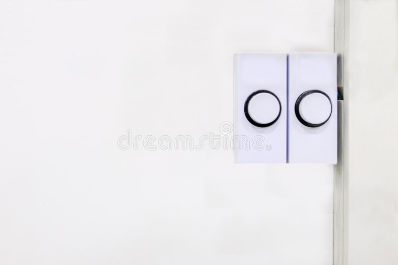 Two white plastic rectangular door bell buttons ready for pushing to alert the occupant that someone is there royalty free stock photos