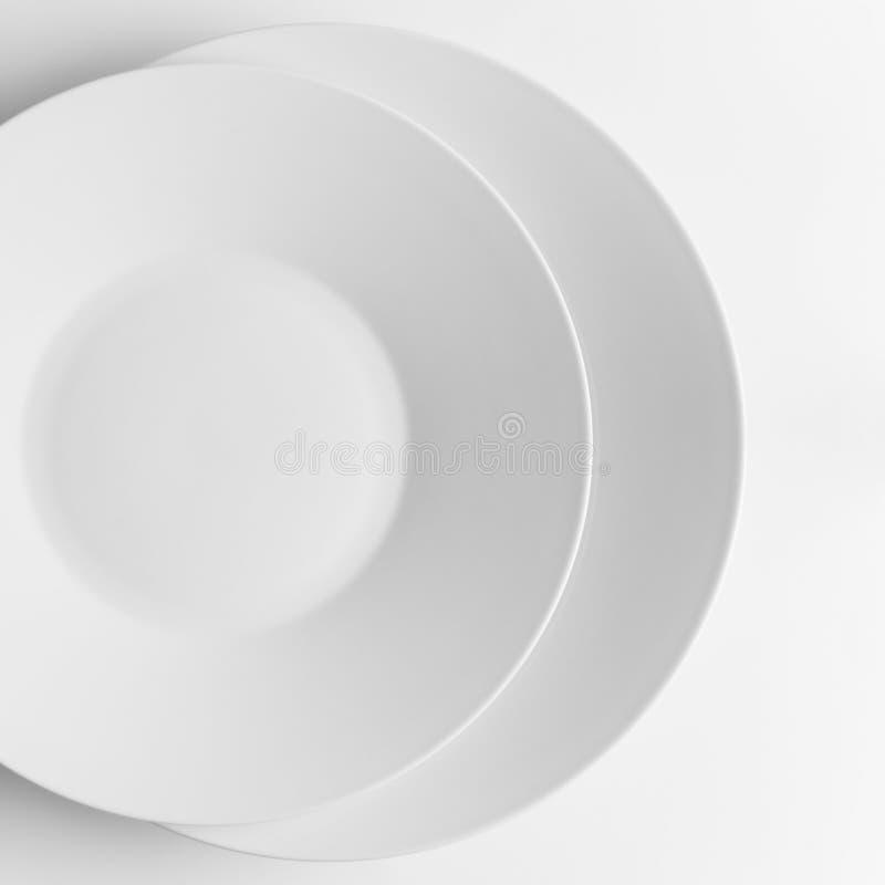 Two white plates royalty free stock photo