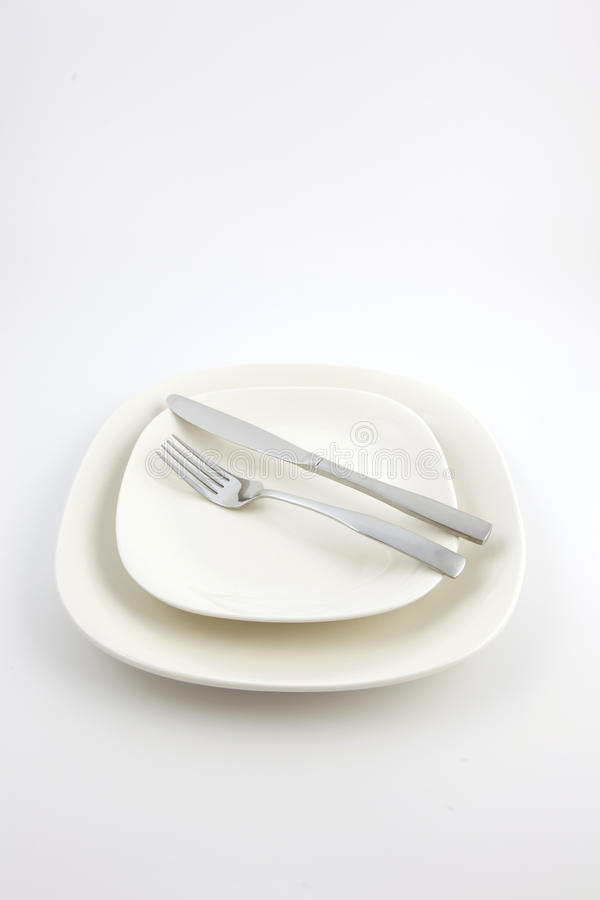 Download Two White Plates And A Knife And Fork Stock Photo - Image: 13209982