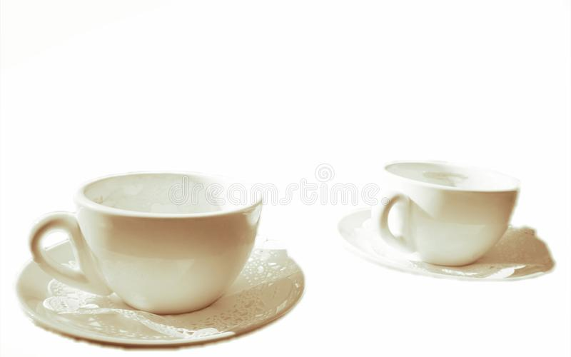 Two white porcelain coffee cups stock images