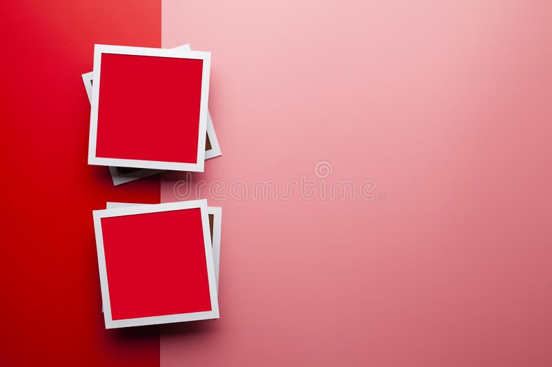 Two white and red photo frames on red and pink background royalty free stock photo