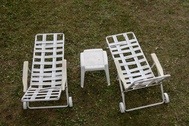 Two White Retro Outdoor Lounge Chairs stock images
