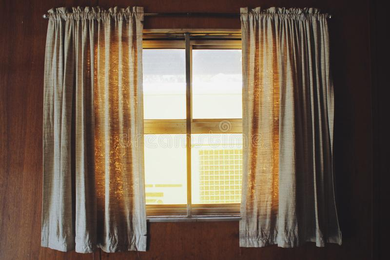 Two White Rod Pocket Curtains royalty free stock images