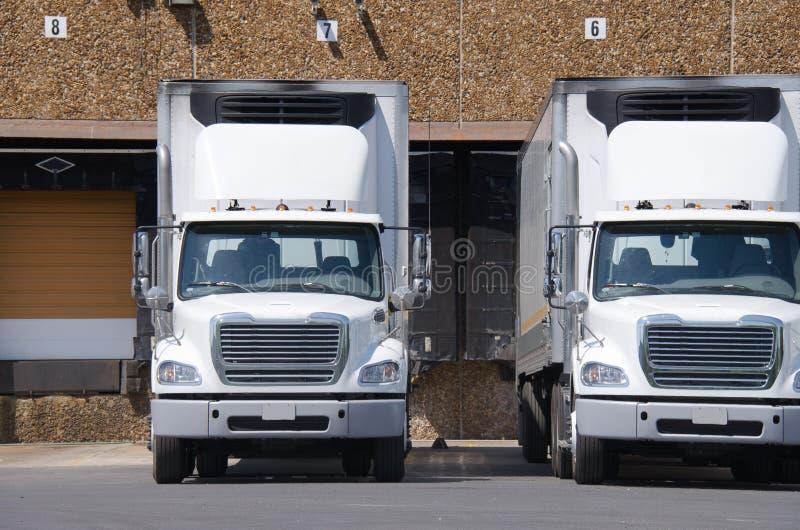 Semi tractor trailer trucks at a loading dock stock photos