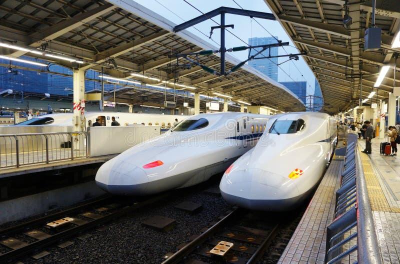 Two white Shinkansen Japanese high speed trains stock photos