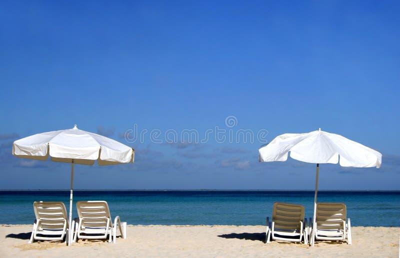 Two White Umbrellas stock images