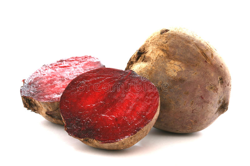 Two whole beetroots also called red beet on white background. One cut stock images