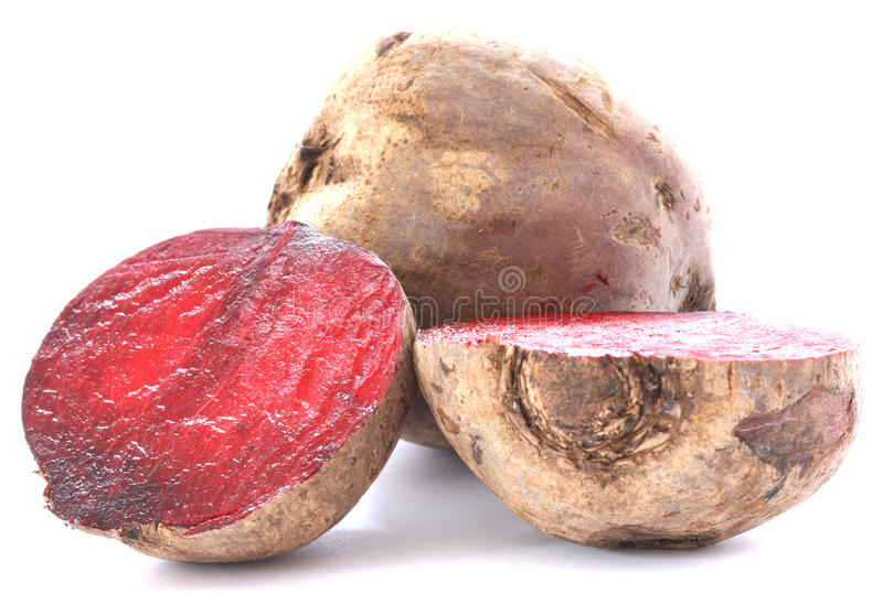 Two whole beetroots on white background. Two whole beetroots also called red beet on white background one cut in half stock photography