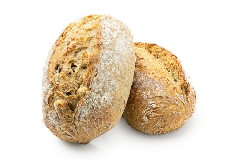 Two whole grain french bread rolls isolated on white.  royalty free stock image