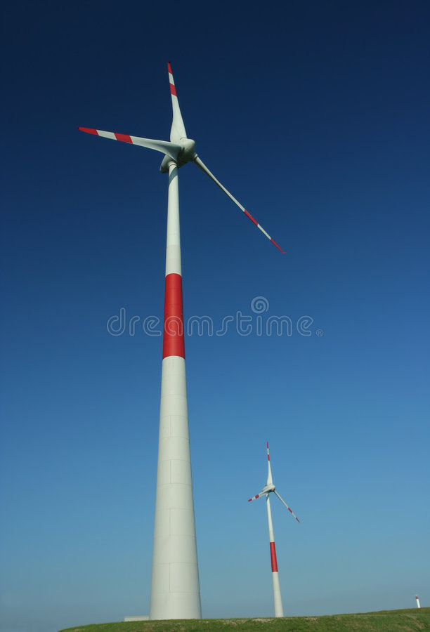 Two windmills. At a wind farm royalty free stock photos
