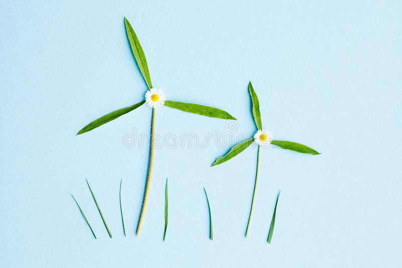 Two windmills made of fresh green leaves royalty free stock photography
