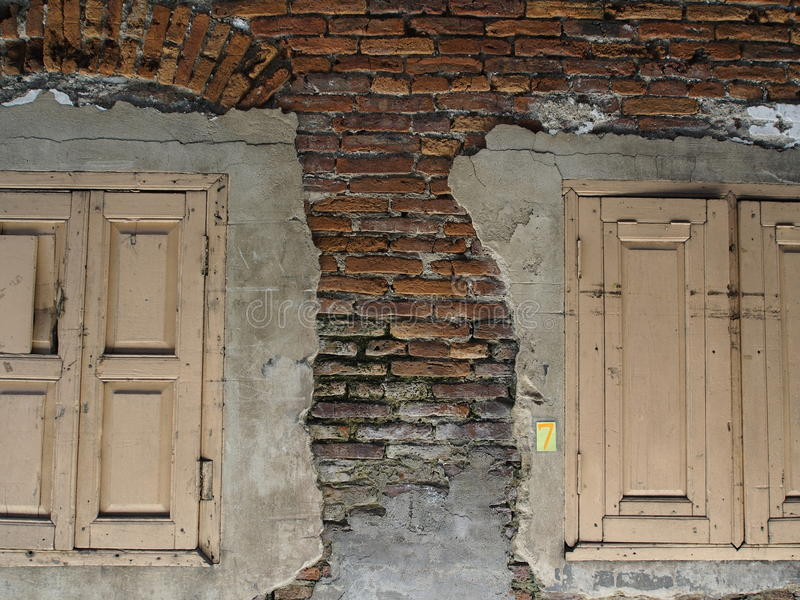 Two windows on brick. Old royalty free stock photos