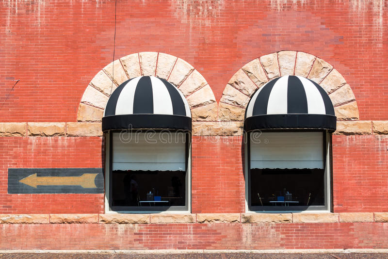 Two Windows in Deadwood, South Dakota. Historic red brick building in Deadwood, South Dakota royalty free stock photo